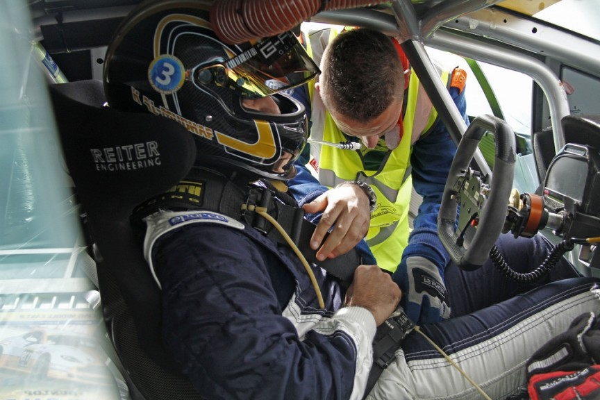 Img 3. Khaled being strapped into the Lamborghini -Img Darren Rycroft
