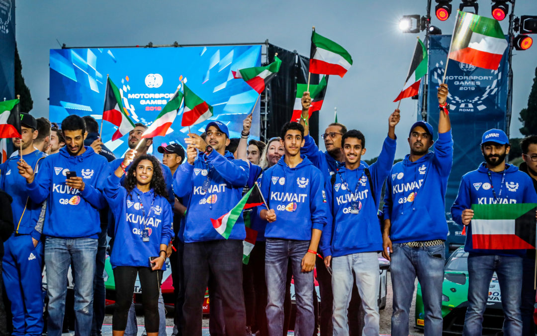 Team Captain Khaled Al Mudhaf raises the flag for Kuwait at FIA Motorsport Games