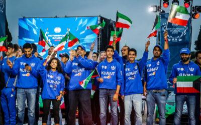 Team Captain Khaled Al Mudhaf raises the flag for Kuwait at FIA Motorsport Games